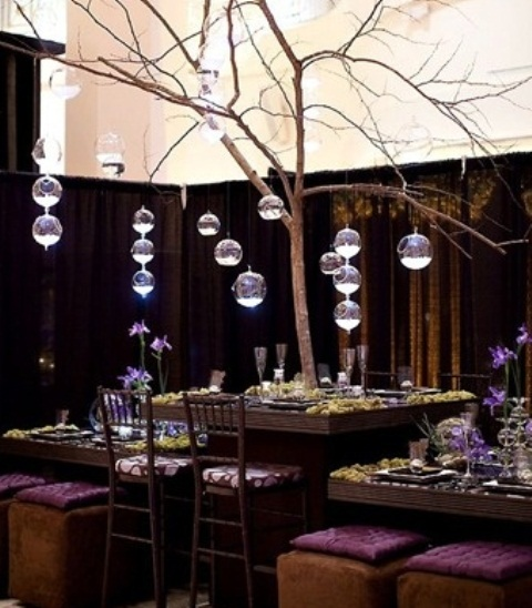 a large tree centerpiece with bubble candle holders and candles is a unique idea