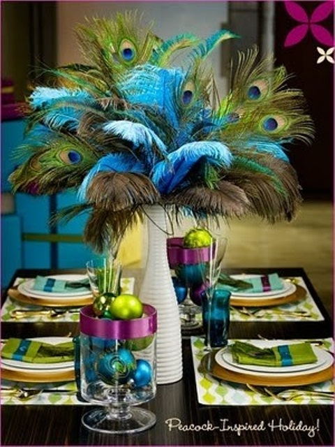 a white vase with colorful peacock feathers, glass bowls with bright ornaments for an artistic New Year wedding