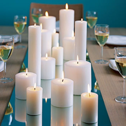 a mirror tray with pillar candles is an easy and budget-friendly wedding centerpiece