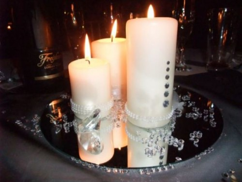 a mirror tray with embellished candles and pearls for a modern wedding