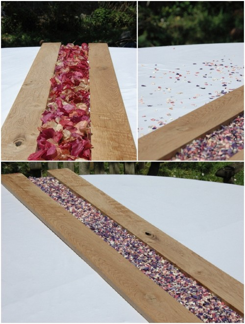 a wooden board with colorful flower petals is a budget-friendly and simple centerpiece idea