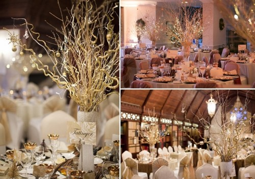 a simple centerpiece with gilded branches in a vase, LEDs and mini lights for a winter wedding