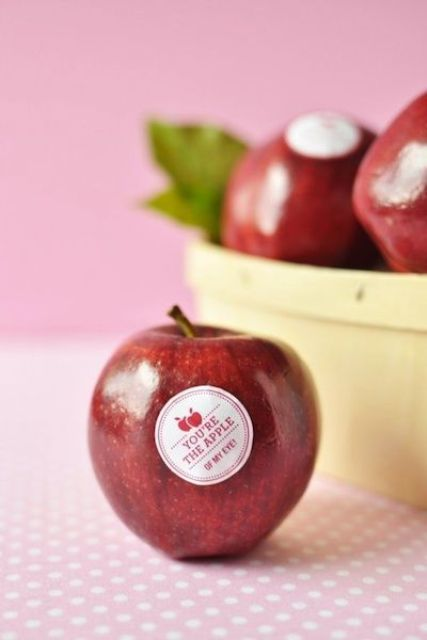 fresh apples with stickers are a nice idea for everyone - they will make your guests healthy and happy