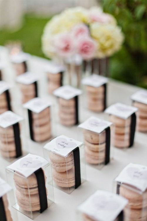 sheer boxes with pink macarons and with tags are elegant and delicious wedding favors