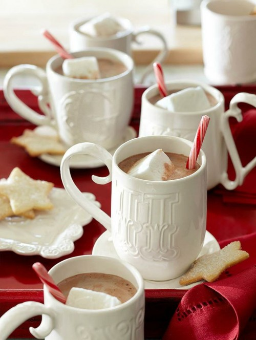 hot chocolate topped with marshmallows and candy canes is a lovely idea of a wedding dessert or just a hot drink to warm everyone up