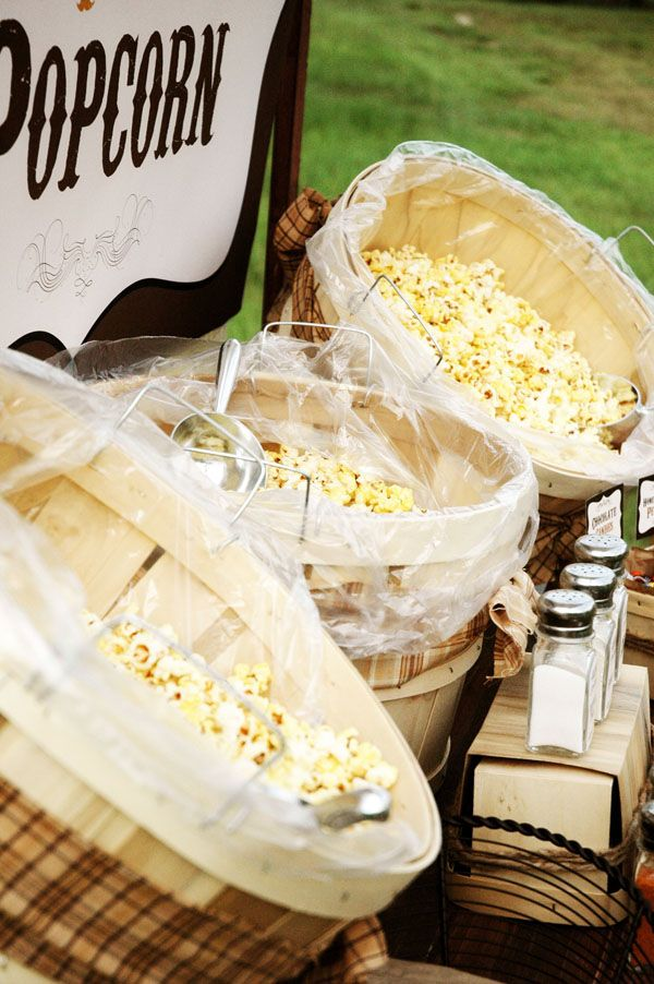 a cool popcorn bar is a timeless idea for a rustic wedding, serve various kinds with different spices and toppings