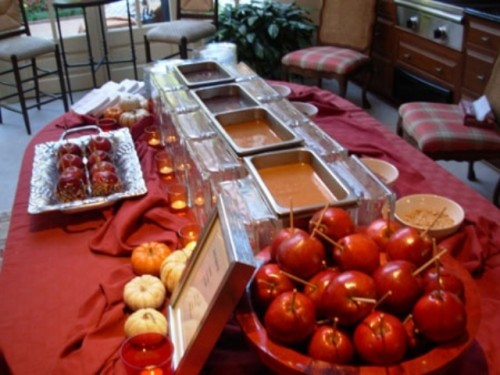 a fall wedding bar with apples and various kinds of dip and chocolate is ideal for the fall