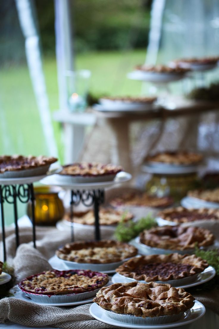 a fall wedding bar with fruit pies is a cool idea for a rustic or any other wedding, it will make guests happy