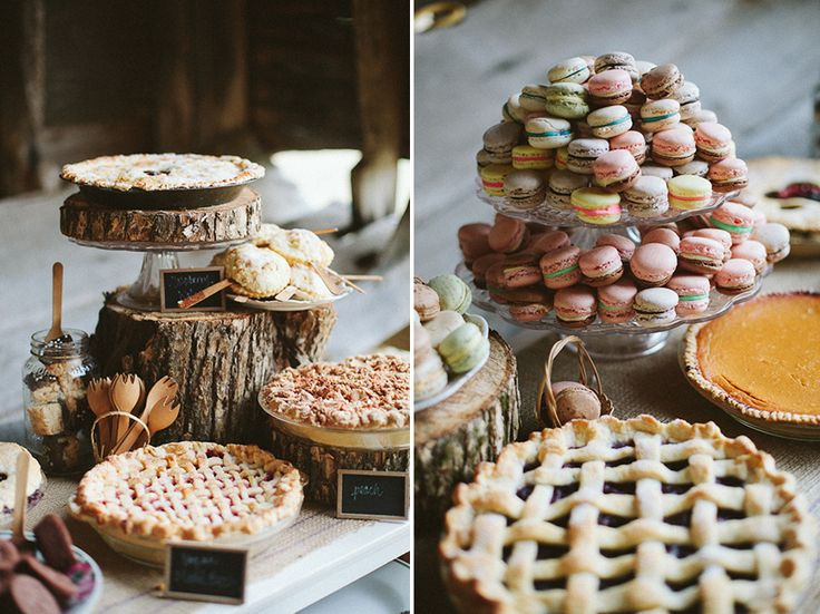 a fall wedding dessert table with homemade pies, macarons and cookies on wood slice stands