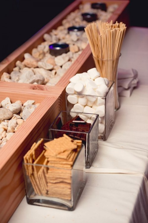 an s'mores bar is a timeless idea for a fall or winter wedding, it does not only cozy up the space but also helps people start a conversation