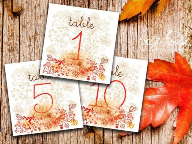 bright floral and leaf print fall table numbers will be a nice match for a fall wedding
