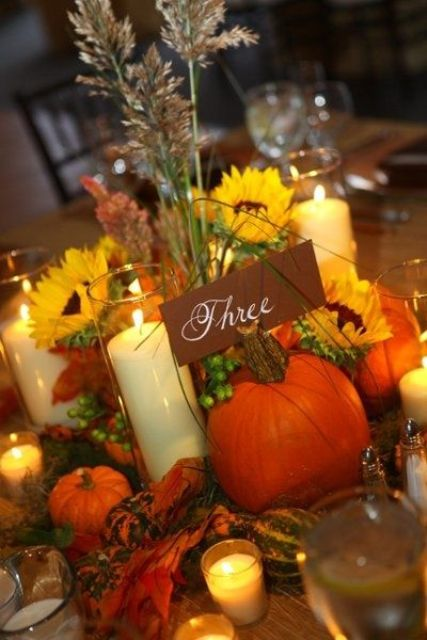 a cardboard calligraphy card is a nice fit for a bright flower, pumpkins and leaf centerpiece and candles