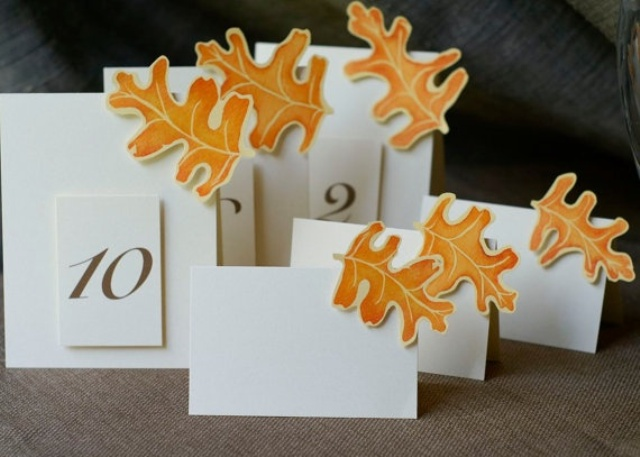 cards with table numbers and bright fall leaves are lovely for a fall wedding and you can DIY them