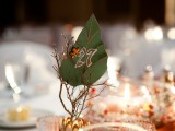 branches with berries, a paper leaf with rhinestones and a table number is a nice fit for a fall wedding