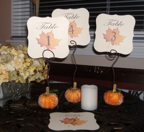 mini glitter pumpkins with wire and cutout cards with leaves and table numbers are very nice and cool decorations to rock