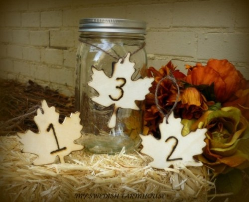 plywood leaves with numbers are nice items for a fall tablescape and will make your centerpiece catchier