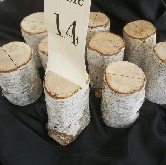 tree stumps with a printed table number are a nice rustic fall decor idea to rock and you can easily DIY them