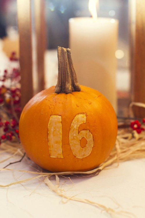 a natural pumpkin with a carved number is a bold and cool farmhouse wedding idea you can make