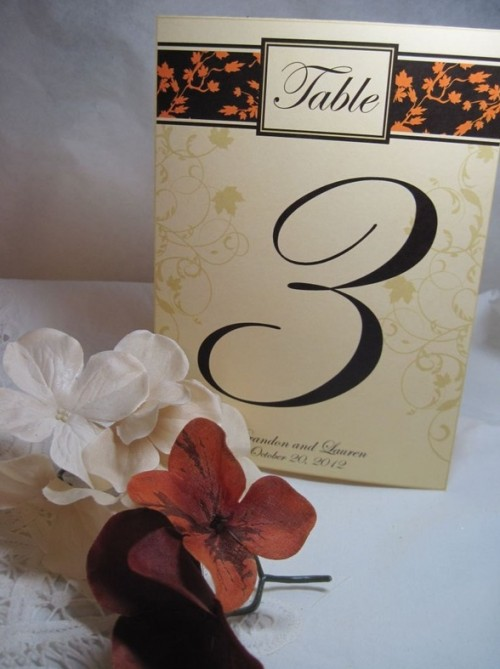 a leaf and bloom printed table number card is a cool and easy piece to add to a centerpiece