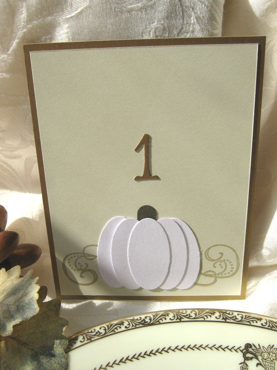 a card with a paper pumpkin and a table number is a perfect fit for a rustic fall centerpeice