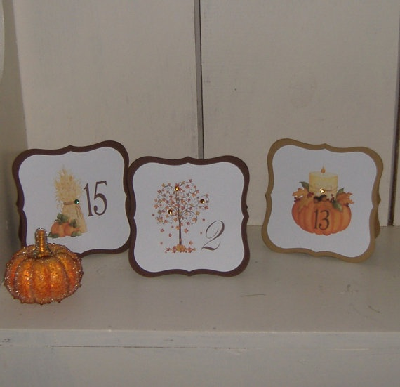 cut out fall cards with leaves, wheat, pumpkins and table numbers will perfectly fit a fall centerpiece
