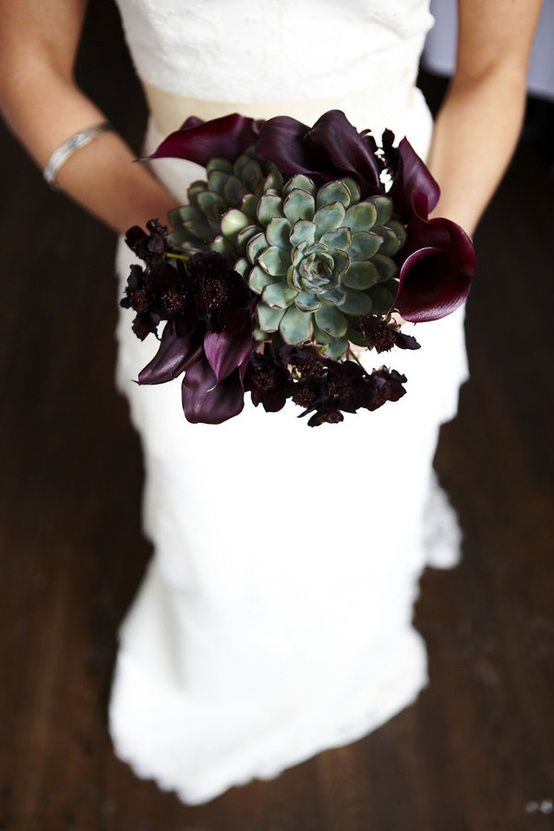 a depe purple Halloween wedding bouquet of callas with a large green succulent is a creative and trendy piece