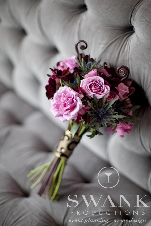 a moody Halloween bouquet of pink and dark blooms, thistles and twigs is a stylish idea for a Halloween bride