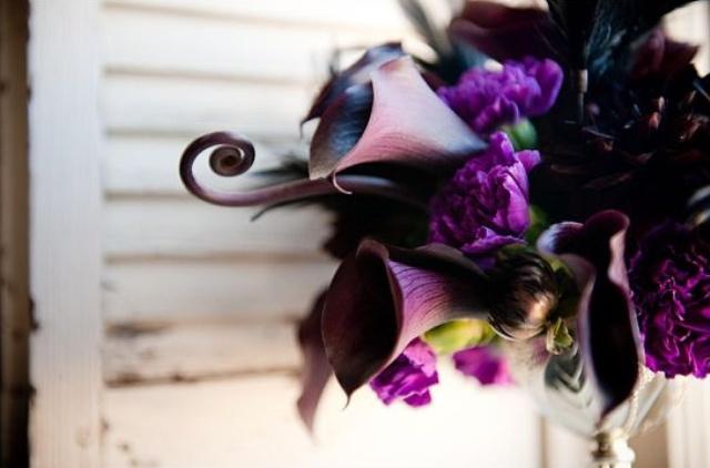 a dark Halloween bouquet of deep purple callas, purple blooms and twigs plus greenery is a stylish idea