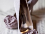 mauve wedding shoes with fabric blooms on top look super chic and elegant