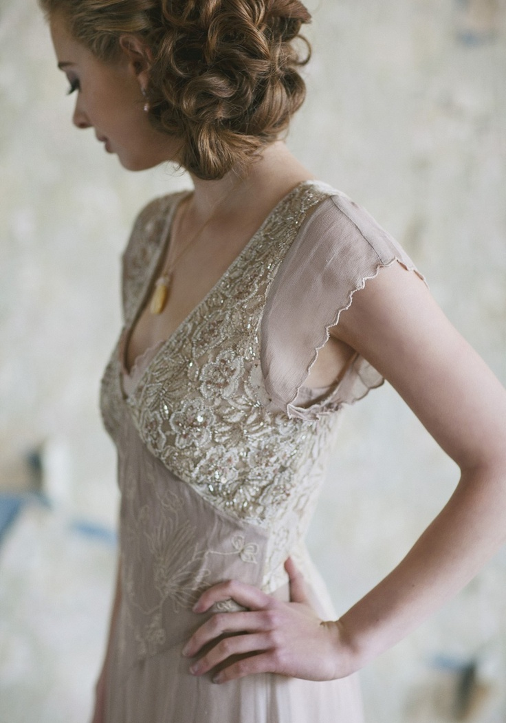 a delicate art deco blush wedding dress with silver embroidery and embellishments