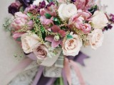 a bright summer wedding bouquet with ivory, mauve, blush, purple blooms and blush ribbons