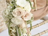 mauve ribbons, mauve and white roses, pearls and greenery for chair decor