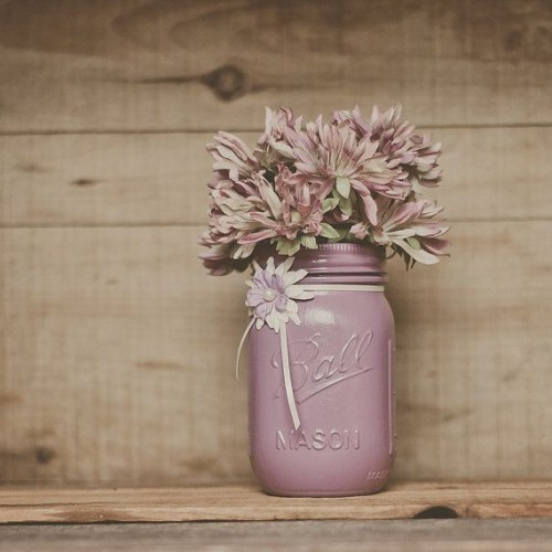a mauve colored mason jar with pink and mauve blooms can be a wedding centerpiece or just a decoration