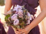 a wedding bouquet of mauve blooms, thistles and succulents is a beautiful and chic option
