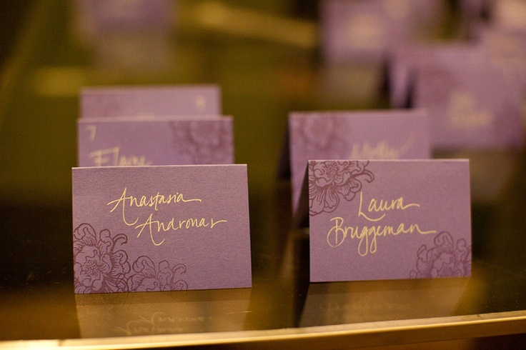 mauve cards with gold calligraphy and botanical decor for your wedding