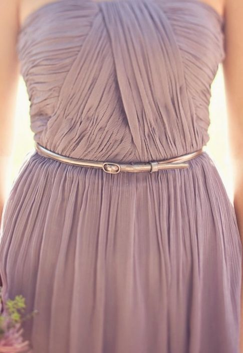 a strapless mauve bridesmaid dress with a draped bodice and an embellished sash
