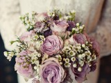 a chic and delicate wedding bouquet of mauve roses and mini white blooms is very cute