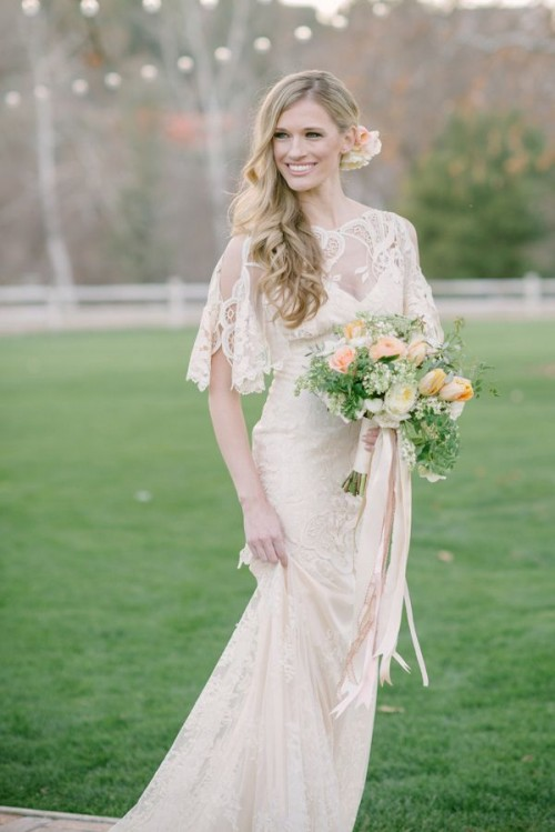 a beautiful peach and cream wedding bouquet with greenery and wildflowers is a refined and elegant idea