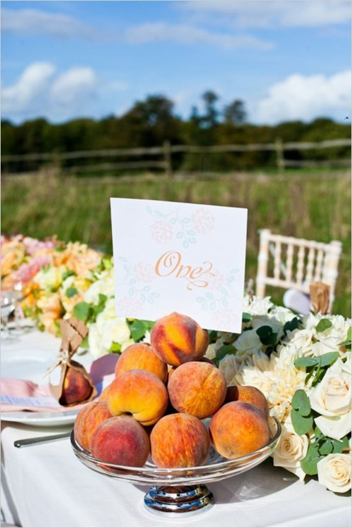 fresh peaches in a silver bowl can be an edible centerpiece or an addition to a lush floral table runner like here