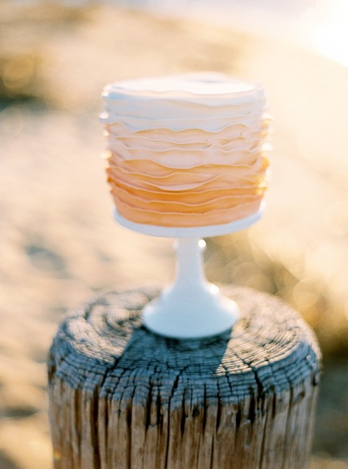 an ombre ruffle wedding cake from white to peachy pink is a beautiful idea for a spring or summer wedding