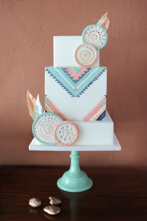 a bright boho wedding cake with colorful geometric patterns and sugar dream catchers in matching colors