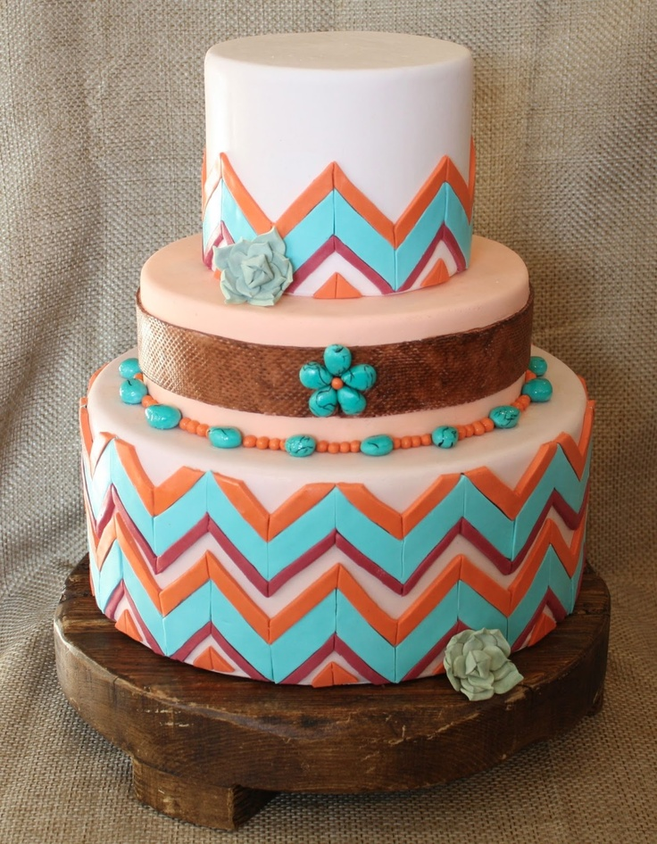 a colorful geometric tier wedding cake with bright pebbles of sugar, beads and sugar blooms for a mid century boho feel