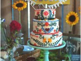 a bright ethnic pattern wedding cake in bold colors is a fun idea for a free-spirited weddings