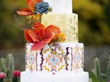 a bright wedding cake with white and gold tiers, a boho ethnical tier, dried herbs and sugar flowers in bold shades