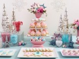 a pastel winter wedding can be complemented with a pastel dessert table in pink and blues, looks unusual and bright