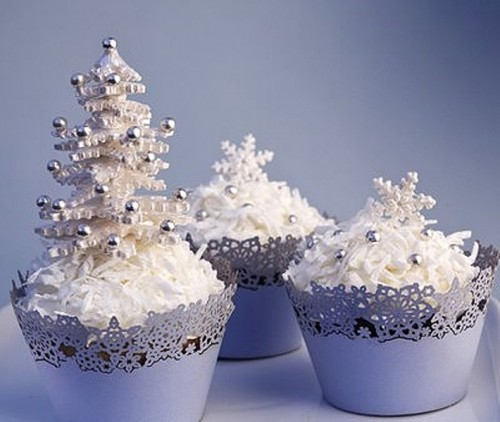 cupcakes with white icing, edible beads and even a mini Christmas tree on top will give your dessert table a fairy-tale feel