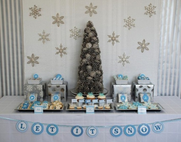 cupcakes and cookies in blue and white and a dessert table styled with blue ornaments and silver snowflakes