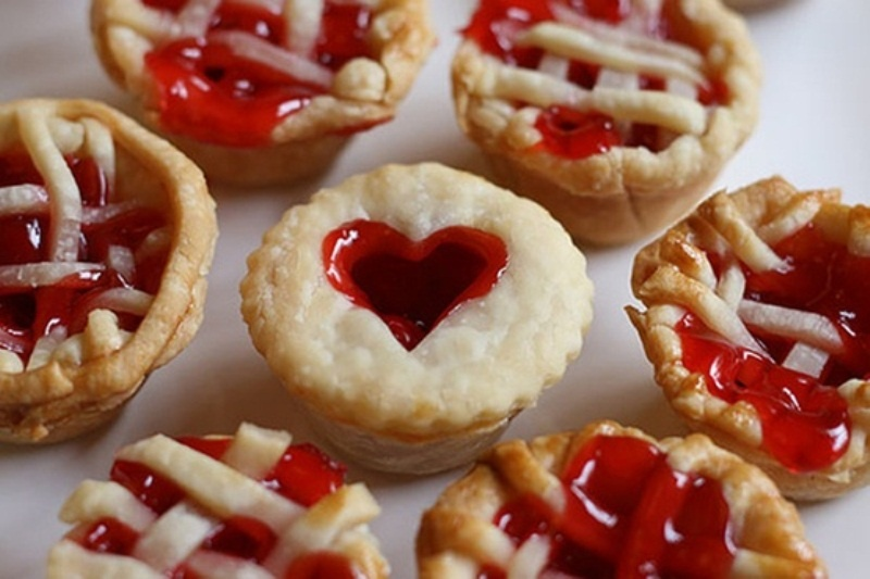 mini pies with hearts on top and with cherry or strawberry jam are very heart warming for a cold winter wedding
