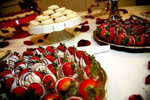 strawberries covered with white and dark chocolate are always a great and super sweet idea of a dessert for any wedding