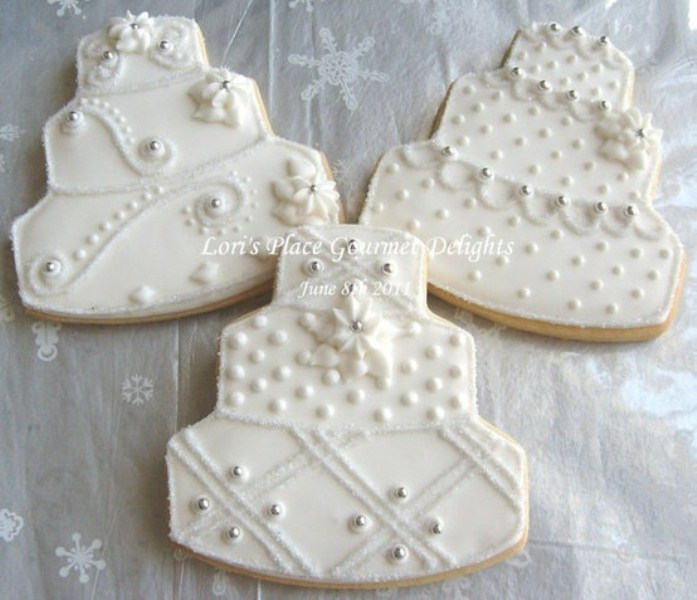 cake shaped cookies with white icing are stylish and refined for a winter wedding